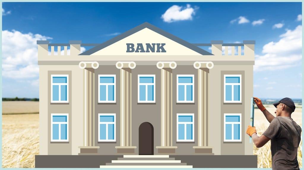Ein Mann nimmt Maß an der Außenwand einer Bank.
